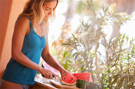 Woman Slicing Watermelon, Near Cabo Pulmo, Baja California Sur, Mexico Stock Photo - Rights-Managed, Code: 700-03616030
