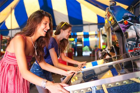 pinball - Two Young Women Playing Arcade Games Stock Photo - Rights-Managed, Code: 700-03613042