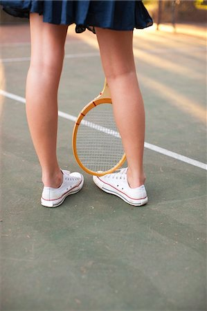 Legs of Young Woman and Tennis Racquet Stock Photo - Rights-Managed, Code: 700-03613052