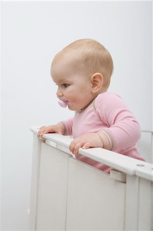 Baby Girl in Crib Stock Photo - Rights-Managed, Code: 700-03621176