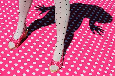 Woman Wearing Polka Dot Tights and Shoes Standing on Polka Dot Surface Stock Photo - Rights-Managed, Code: 700-03623023