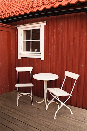 red chair - Table and Chairs in front of Hose, Sweden Stock Photo - Rights-Managed, Code: 700-03638834