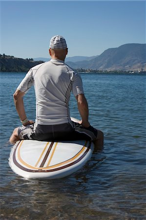 Man Stand Up Paddle Surfing, Okanagan Lake, Penticton, British Columbia, Canada Stock Photo - Rights-Managed, Code: 700-03638955