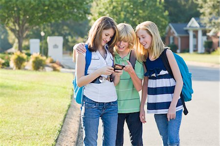 Group of Friends with Cell Phone Going to School Stock Photo - Rights-Managed, Code: 700-03644534