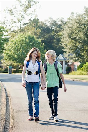 preteen girl boyfriends - Boy and Girl Walking and Holding Hands Stock Photo - Rights-Managed, Code: 700-03644535