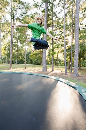 Boy Jumping on Trampoline Stock Photo - Rights-Managed, Code: 700-03644538