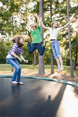 Group of Friends Jumping on Trampoline Stock Photo - Rights-Managed, Code: 700-03644539