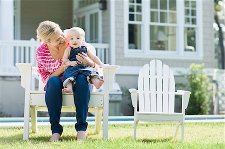 Mother and Son Sitting in Chair on Lawn Stock Photo - Rights-Managed, Code: 700-03644549
