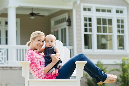 Mother and Son Sitting in Chair on Lawn Stock Photo - Rights-Managed, Code: 700-03644554