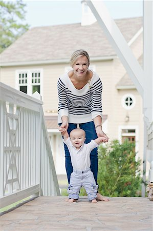Mother Helping Son to Walk Stock Photo - Rights-Managed, Code: 700-03644556