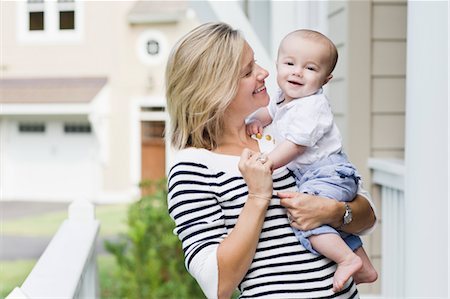 Mother and Son Outside of Home Stock Photo - Rights-Managed, Code: 700-03644558