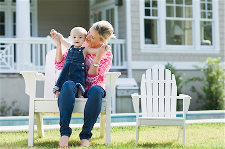 Mother and Son Sitting in Chair on Lawn Stock Photo - Rights-Managed, Code: 700-03644550