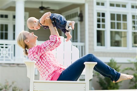 Mother and Son Sitting in Chair on Lawn Stock Photo - Rights-Managed, Code: 700-03644553