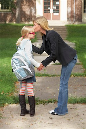Mother Kissing Daughter Goodbye in Front of School Stock Photo - Rights-Managed, Code: 700-03644812