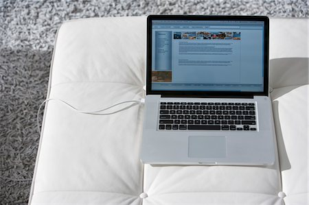 Laptop Computer on Ottoman Stock Photo - Rights-Managed, Code: 700-03654482