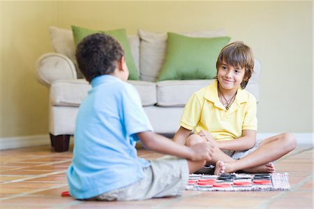 Boys Playing Checkers Stock Photo - Rights-Managed, Code: 700-03659109