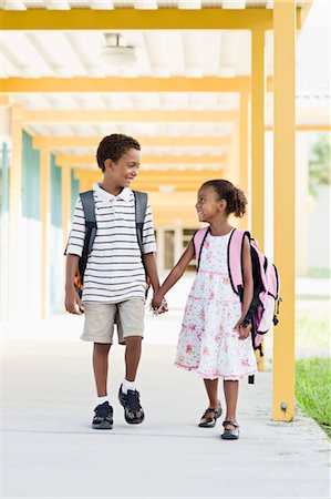 Brother and Sister Walking Together at School Stock Photo - Rights-Managed, Code: 700-03659119