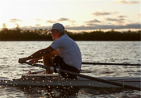 side view of person rowing in boat - Man Rowing, Toronto, Ontario, Canada Stock Photo - Rights-Managed, Code: 700-03659177