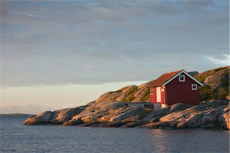Red Wooden Hut on Rocky Coast, Bohuslaen, Sweden Stock Photo - Rights-Managed, Code: 700-03659272