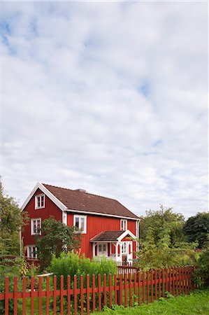 Red Wooden House and Fence, Bullerbue, Smaland, Sweden Stock Photo - Rights-Managed, Code: 700-03659288