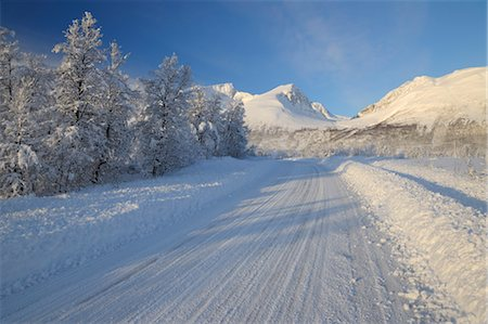 roads and sun - Road in Winter, Breivikeidet, Troms, Norway Stock Photo - Rights-Managed, Code: 700-03665473