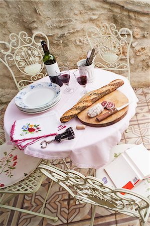 french (places and things) - Bread and Wine on Table, Caunes-Minervois, Aude, Languedoc-Roussillon, France Stock Photo - Rights-Managed, Code: 700-03665584