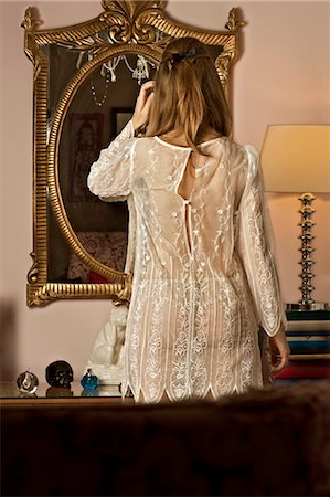 Back of Woman Wearing Lingerie and Looking into Mirror Stock Photo - Rights-Managed, Code: 700-03665857