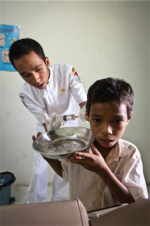 Boy Being Treated for Ear Infection, Hobawawi Clinic, Sumba, Indonesia Stock Photo - Rights-Managed, Code: 700-03665851