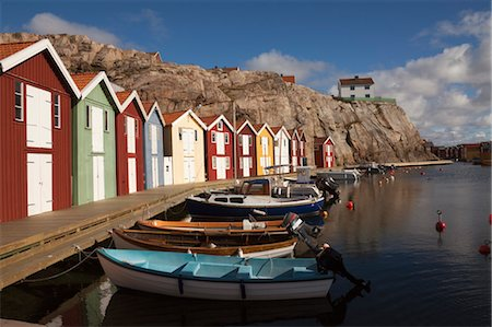 Row of Houses, Smogen, Bohuslaen, Vastra Gotaland County, Gotaland, Sweden Stock Photo - Rights-Managed, Code: 700-03685774