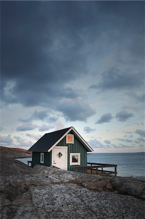 Hut on Shoreline at Sunset, Bohuslaen, Vastra Gotaland County, Gotaland, Sweden Stock Photo - Rights-Managed, Code: 700-03685775