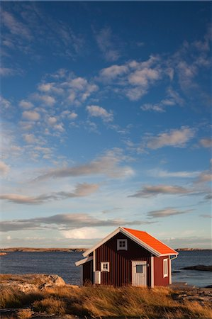 Red Wooden Hut on Shoreline, Bohuslaen, Vastra Gotaland County, Gotaland, Sweden Stock Photo - Rights-Managed, Code: 700-03685779