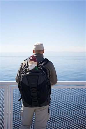 dwarf - Man with Gnome in Backpack on Ferry, Strait of Georgia, British Columbia, Canada Stock Photo - Rights-Managed, Code: 700-03685837