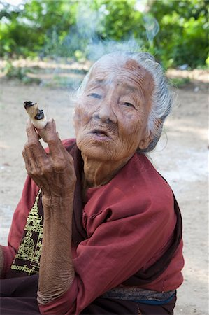 Portrait of Senior Woman Smoking, Monywa, Myanmar Stock Photo - Rights-Managed, Code: 700-03685883