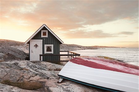 quaint house - Hut on Shoreline at Surise, Bohuslaen, Vastra Gotaland County, Gotaland, Sweden Stock Photo - Rights-Managed, Code: 700-03685935