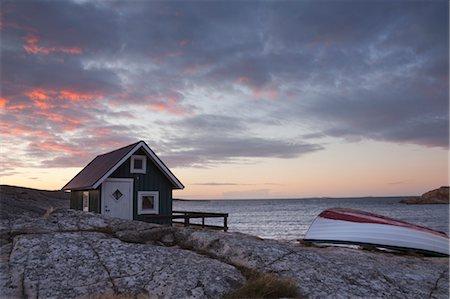 quaint house - Hut on Shoreline at Sunrise, Bohuslaen, Vastra Gotaland County, Gotaland, Sweden Stock Photo - Rights-Managed, Code: 700-03685936