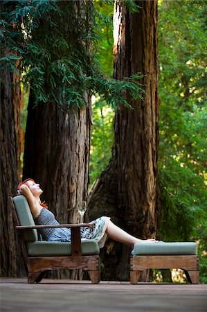 Woman Relaxing on Deck, Santa Cruz County, California, USA Stock Photo - Rights-Managed, Code: 700-03686111