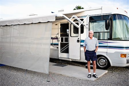 Man Standing in front RV in Trailer Park, Yuma, Arizona, USA Stock Photo - Rights-Managed, Code: 700-03686137