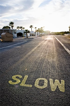 'Slow' Traffic Sign on Street in RV Park, Yuma, Arizona, USA Stock Photo - Rights-Managed, Code: 700-03686138
