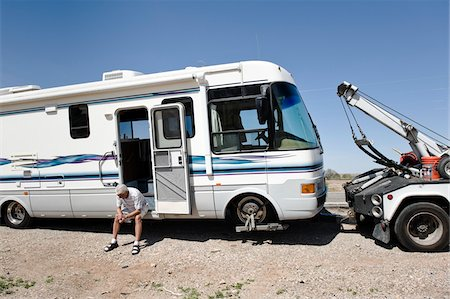 Man with Broken Down RV and Tow Truck in towed in Desert, near Yuma, Arizona, USA Stock Photo - Rights-Managed, Code: 700-03686142
