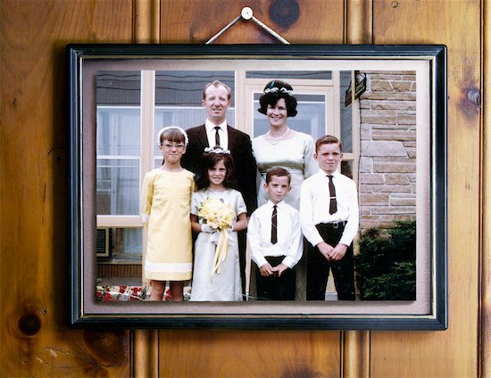 Vintage 1960s Family Portrait Hanging on Wood Panelled Wall Stock Photo - Premium Rights-Managed, Artist: Andrew Kolb, Image code: 700-03681997