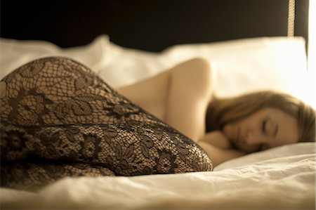 Woman Lying in Bed Wearing Lace Stockings Stock Photo - Rights-Managed, Code: 700-03682326