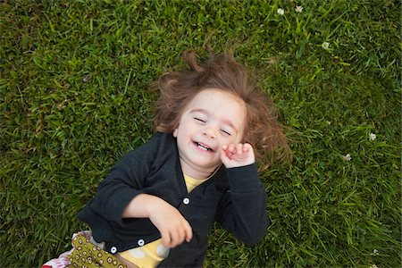 roll (people and animals rolling around) - Little Girl Rolling on Grass and Laughing Stock Photo - Rights-Managed, Code: 700-03696879