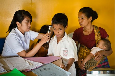 Boy Receiving Treatment for Ear Infection at Hobawawi Clinic, Sumba, Indonesia Stock Photo - Rights-Managed, Code: 700-03696915