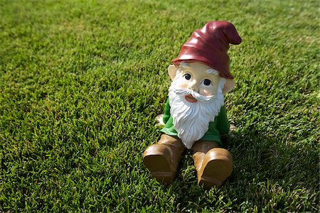 dwarf - Gnome Sitting on Lawn Stock Photo - Rights-Managed, Code: 700-03697934