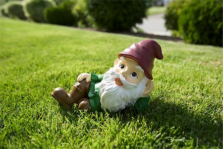 dwarf - Gnome Relaxing on Lawn Stock Photo - Rights-Managed, Code: 700-03697935