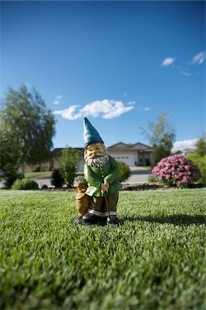 dwarf - Golfing Gnome Statue on Lawn, Pentiction, Okanagan Valley, British Columbia, Canada Stock Photo - Rights-Managed, Code: 700-03697936