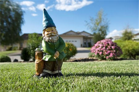 dwarf - Golfing Gnome Statue on Lawn, Pentiction, Okanagan Valley, British Columbia, Canada Stock Photo - Rights-Managed, Code: 700-03697937