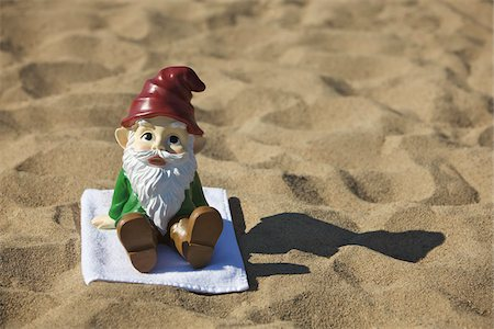 dwarf - Gnome Sitting on the Beach Stock Photo - Rights-Managed, Code: 700-03697930