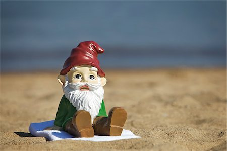 dwarf - Gnome Sitting on the Beach Stock Photo - Rights-Managed, Code: 700-03697931