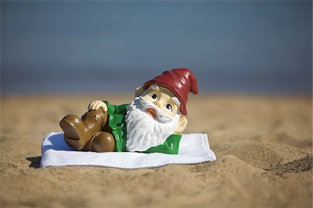 Gnome Relaxing on the Beach Stock Photo - Rights-Managed, Code: 700-03697932